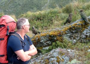 Chris exchanges pleasantries with some Kea