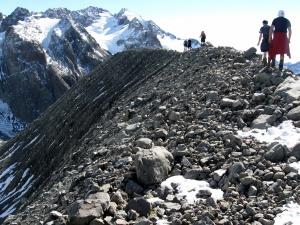 Walking a broken rock ridge above Barker Hut