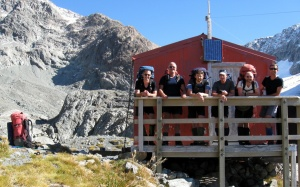 The Moa Hunters pose at the Barker Hut before heading down the valley