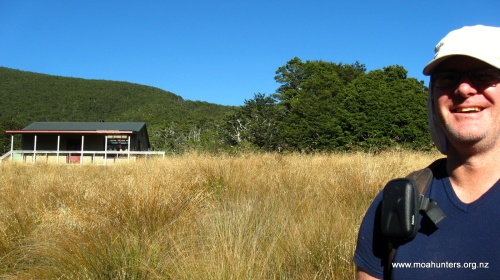 Mighty Moa Hunter Chris in front of Speargrass hut.